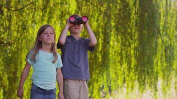 Two kids looking through binoculars video