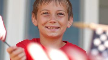 Boy waving American flag, shot on Phantom Flex 4K video