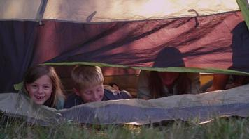 Family looking out from tent video