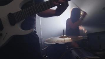 Guitar and drums in heavy metal rock band, slow motion video