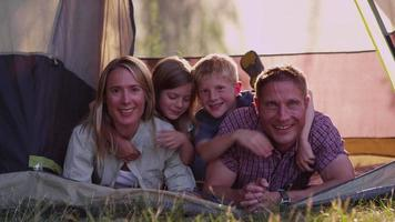 Portrait of camping family in tent video