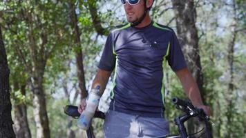 Mountain biker takes a water break video