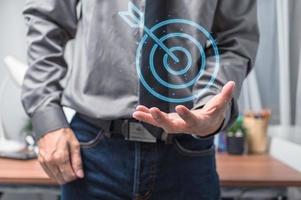 businessman showing symbol target of business photo