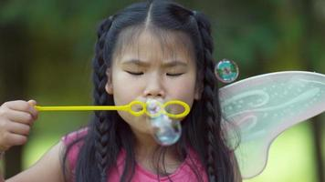 Girl in fairy princess costume blowing bubbles video