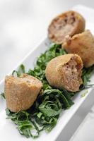 Fried beef croquettes traditional starter snack food in Portugal photo