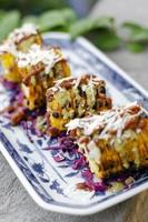 Mexican spicy bbq sweet corn tapas snack with chili sauce and cheese photo