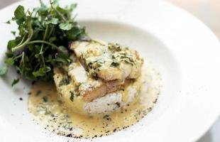 Sea bream fish fillet in creamy mustard dill and lemon sauce restaurant meal on plate photo