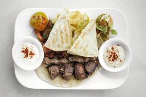 Lebanese meshwi mixed bbq grilled meat set with chicken, lamb and beef in Beirut restaurant photo