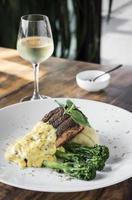 Grilled salmon fish fillet with mashed potato and dijon mustard cream sauce photo