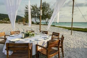 Romantic wedding table design at sunset outside on tropical Asian beach in Bali Indonesia photo