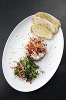 Raw marinated sea bass fish ceviche salad modern gourmet fusion cuisine starter set in Melbourne Australia restaurant photo