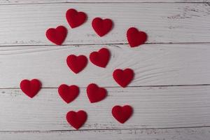 Red heart on white wood background. photo