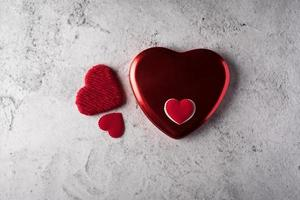 Top view Red heart on wall background. photo