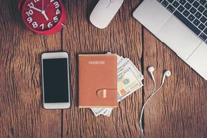 Top view passport with money on workspace, tourism concept. photo
