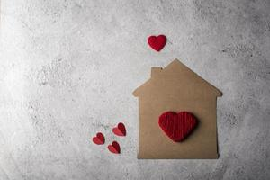 Paper house with heart flat design. photo