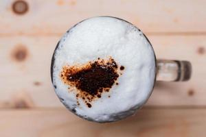 Top view of iced coffee froth in cup photo