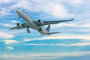 Commercial airplane flying with blue sky background photo