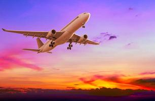 Commercial airplane flying at sunset photo