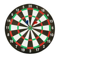 dartboard with red and blue darts on white with clipping path photo