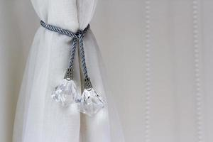 Airy curtain with curtain tie in the bedroom photo