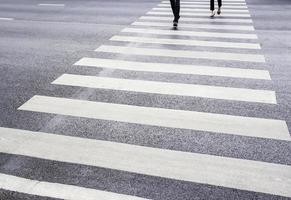 People are walking on the  zebra crossing photo