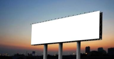 Blank billboard at twilight photo