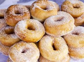 Close up sugar donuts photo