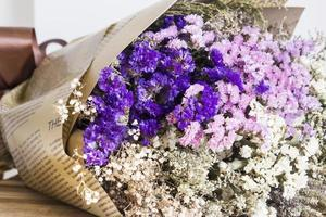 Bouquet of dried flowers on the wooden table photo