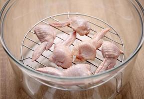 Raw chicken wings in oven photo