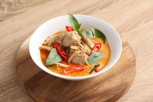 Thai chicken and bamboo shoot curry in ceramic bowl photo
