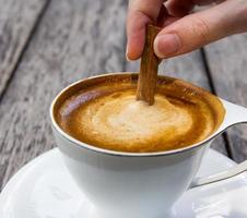hot coffee on wooden table photo