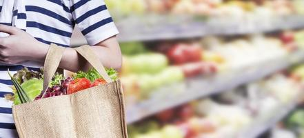 Young woman are shopping in the supermarket photo