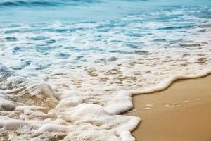 Soft wave on the sandy beach photo