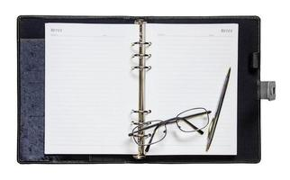 notebook pen with glasses photo