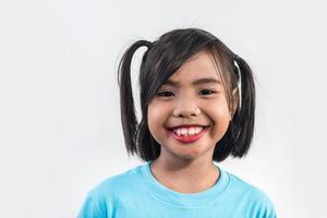 Portrait of Funny little girl acting in studio shot. photo