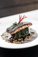 Salmon fillet with steamed spinach and corn with sweet soy and oyster sauce photo