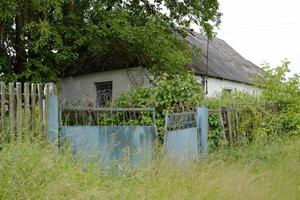 Beautiful old abandoned building farm house in countryside photo