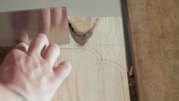 A Carpenter Cuts a Piece from A Pine Board video