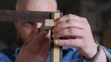 Carpenter Checks the 90 Degree Angle with Try Square video
