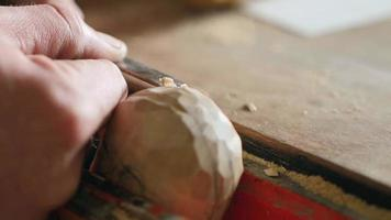Woodcarver Carves a Helmet with A Chisel video