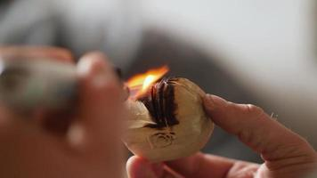 Woodworker Burns a Piece of Wood with A Gas Burner video