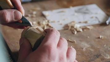 A Woodcarver Carves a Helm video