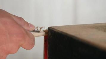 Carpenter Carves Wood Plug video