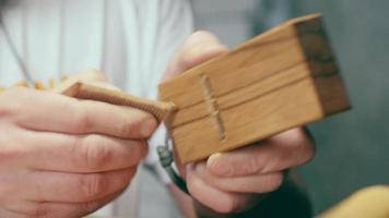 Wood Craftsman Processes a Wooden Comb with A Planer video