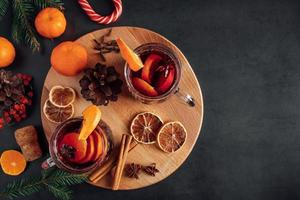 Hot mulled wine. Warm winter drink with spices and fruits photo
