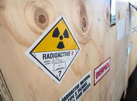 Radiation label beside the transport wooden box Type A package photo