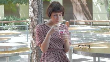 Young Woman Eat Ice Cream Outdoors video