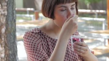 Woman Eat Ice Cream Outdoors video