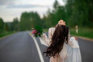 woman on empty road photo
