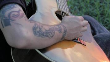 Close up Of a Guy Playing on A Acoustic Guitar video